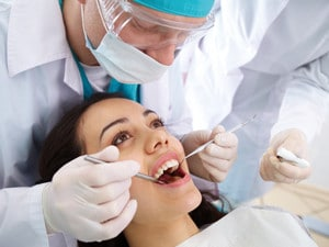 What Are The Main Signs of Infection After Tooth Extraction?
